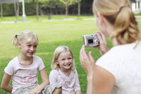 Woman taking pictures of her daughters