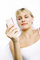 Woman text messaging on her mobile phone