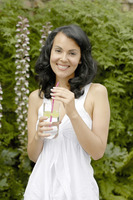 Woman with a glass of lime juice