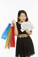Woman with a lot of money carrying paper bags