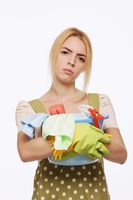 Woman with a pail of cleaning products