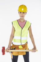 Woman with construction equipment