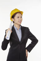 Woman with construction helmet and safety glasses holding a roll of paper
