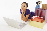 Woman with laptop and shopping items