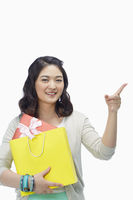 Woman with paper bag pointing to the left