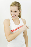 Woman with the word 'handle with care' on her sleeveless top