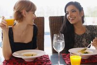 Women chatting while eating together