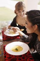 Women enjoying pumpkin soup