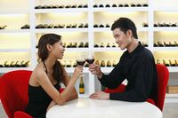 Young couple toasting wine