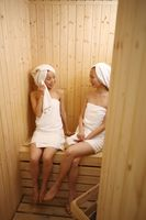 Young women in sauna, chatting