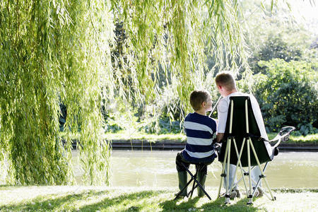 Park Outdoor : Boy fishing with his younger brother