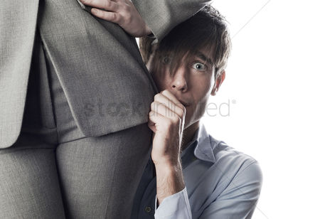 Girl : Businessman hiding behind businesswoman