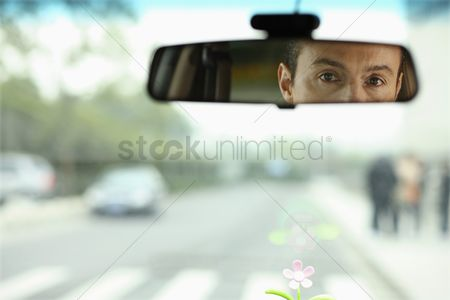Interior : Businessman reflected in rear view mirror