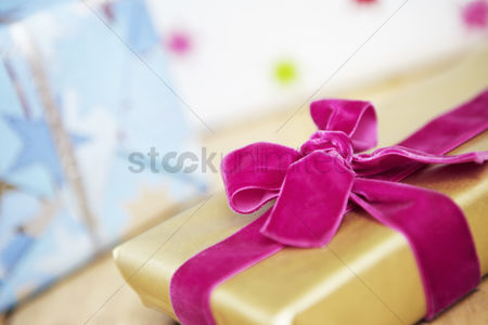 Interior : Christmas present wrapped with velvet bow close up