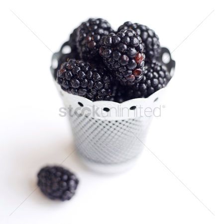 Background : Close up of some blackberries in a container
