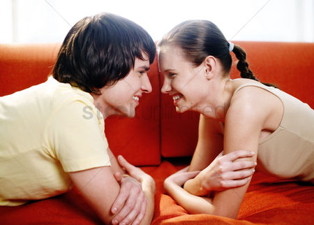Romantic : Couple lying on the couch facing each other