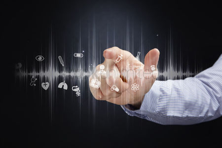 Heart : Finger pointing at digital medical icons
