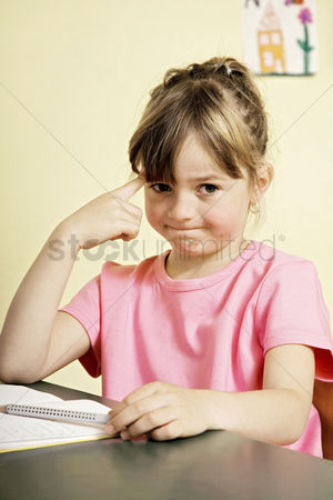 School : Girl thinking while sitting at her table