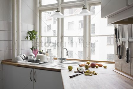 Interior : Kitchen worktop with chopped fruit and veg in urban apartment