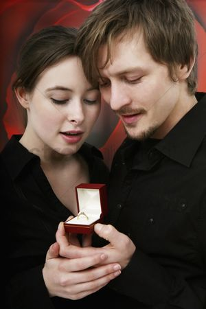 Romantic : Man and woman looking at engagement ring