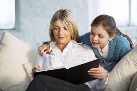 Girl : Mother and daughter sharing a book