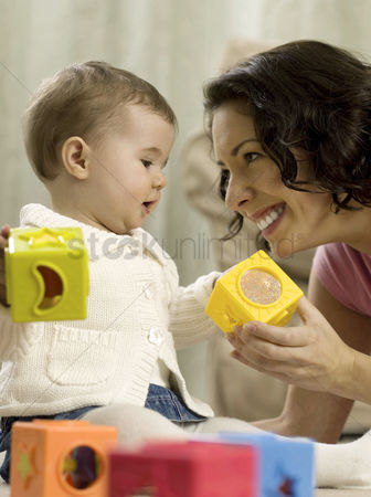 Girl : Mother playing with baby girl