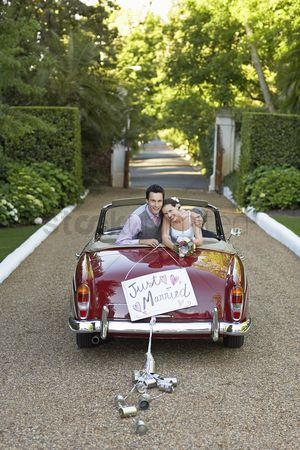 Wedding : Portrait of newlyweds in vintage convertible