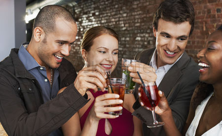 Party : Two couples toasting standing in bar