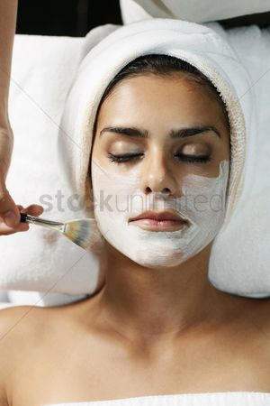 Spa : Woman having facial mask applied with brush