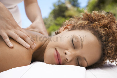 Spa : Woman receiving massage head and shoulders eyes closed