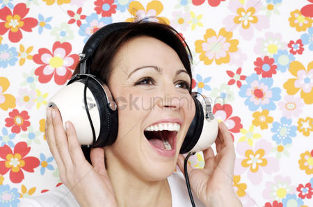 Background : Woman smiling while listening to music on the headphones