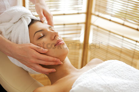 Spa : Young woman receiving massage  eyes closed