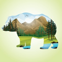 Double exposure of bear and mountainscape