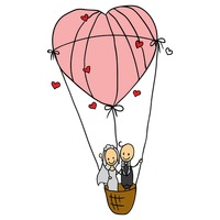 Wedding couple in a heart shaped air balloon