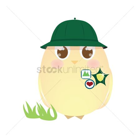 Grass : A chick wearing a hat and badges