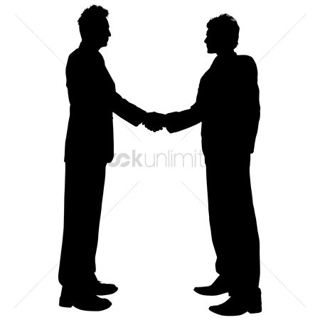 Business deal : Businessman shaking hands silhouette