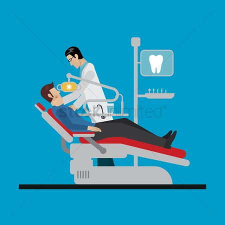 Dentist : Dentist treating his patient