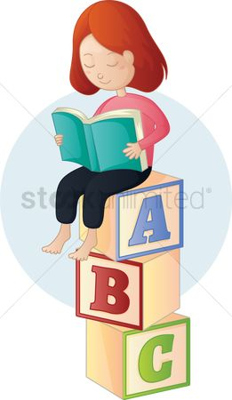 Blocks : Girl sitting on stack of blocks reading