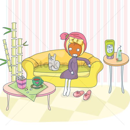 Indoor : Girl with face pack sitting on sofa