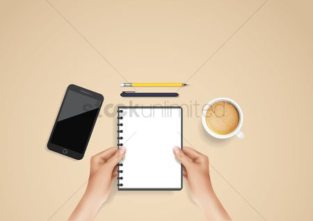 Phones : Hand holding notebook flatlay