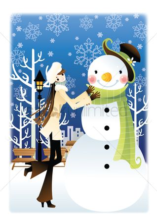 Warm : Young woman making a snowman
