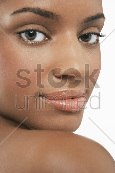 beautiful young  looking over shoulder stock photo