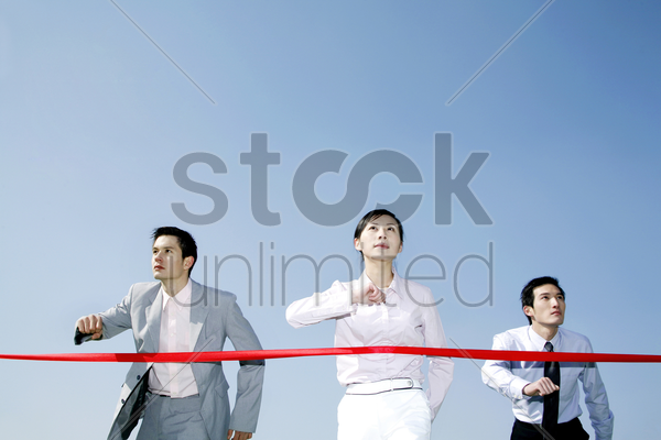 business people walking towards the finishing line stock photo