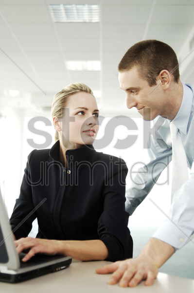 businessman courting his colleague stock photo