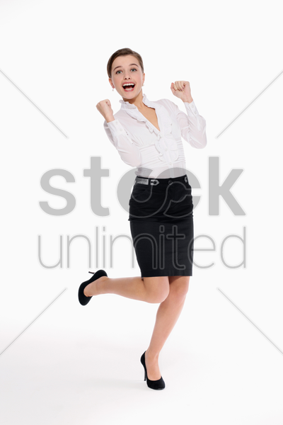 businesswoman celebrating her success stock photo