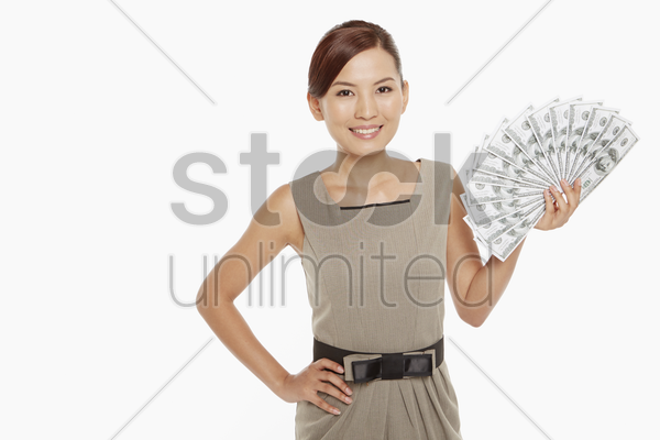 businesswoman holding a pile of cash stock photo