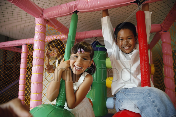 children playing with rope swing indoors stock photo