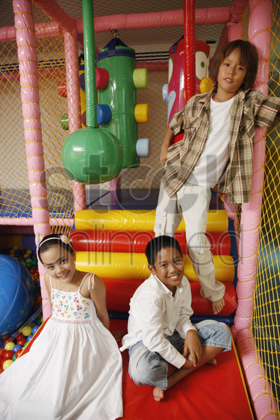 children posing in indoor playground stock photo