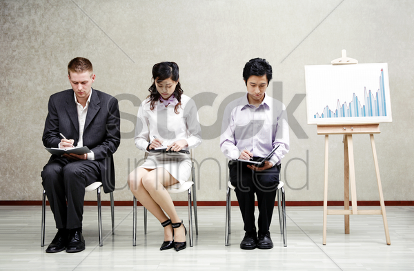 corporate people busy writing stock photo