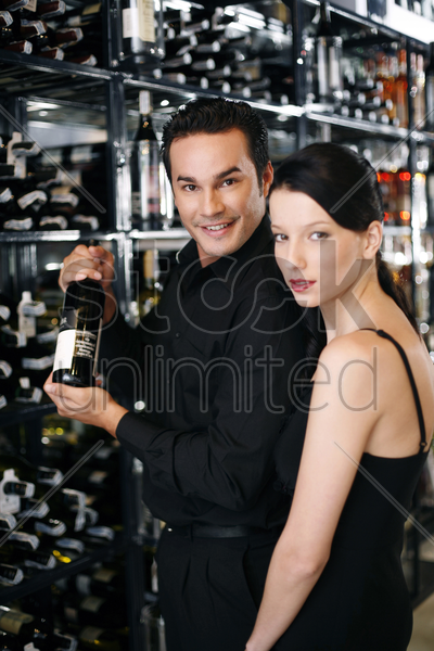 couple choosing wine in the wine cellar stock photo